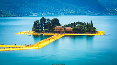 Ghosts on the piers (Nicola Pezzoli) Tags: floating piers lake iseo brescia bergamo blue yellow colors nature canon lombardia italy monte isola sulzano island art design mountain water reflections tourism people san paolo long exposure