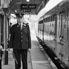 Guard at Dereham Station (johnnewstead1) Tags: monochrome blackwhite johnnewstead olympus mzuiko em1 omd train rail carriage trainguard guard mnr midnorfolkrailway dereham norfolk station platform