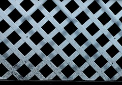 Lattice (Noel C. Hankamer) Tags: abstract backdrop background backgrounds carpentry design element fence frame grain image lattice material mesh panel pattern photo striped surface texture textured wood mobilehome trailer crisscross white shadows