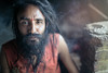 "Baba, the sadhu of a Kathmandu's slum posing while smoking ganja. His temple collapsed after the earthquake. But Baba never feels sad. ""This is the power of Gods"" he said (Fabien Lasserre -) Tags: nepal eye look yoga canon beard intense bokeh smoke naturallight smoking kathmandu slum sadhu f12 ganja markiii eathquake bidonville bagmati tremblementdeterre काठमाडौं katamandou sādhu साधु"