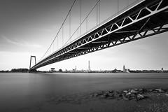 Hanging Emmerich wide mono (frank_w_aus_l) Tags: longexposure bridge bw reflection industry water monochrome architecture river de deutschland nikon rhein nordrheinwestfalen kleve emmerich 1424 d810