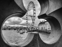 Through The Eye Of A Floret London by Simon & His Camera (Simon & His Camera) Tags: city bridge sky urban blackandwhite bw cloud building london water monochrome thames skyline architecture river boat pattern outdoor londoneye round iconic simonandhiscamera