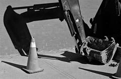 Back Hoe (geowelch) Tags: toronto blackwhite 35mmfilm urbanlandscape pentaxmx libertyvillage urbanfragments xp2super400 pentaxm50mmf17 plustekopticfilm7400