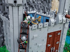 Once more to the breach, my dear friends, once more! (Robert4168/Garmadon) Tags: lego castle goh colossal battle contest waterfall river water siege ladder attack snow mountain fisherman towers blue dark gold light green minifigure minifigures minifig interior battlements crenelations palace