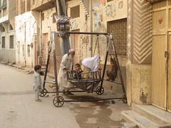 Fun at Doorstep (Raees Mughal) Tags: raees raeesmughal peshawar pakistan child childhood play old young street fun