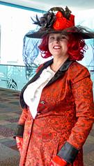 Comic Expo Character (J Wells S) Tags: candidportrait makeup portrait woman prettywoman cincinnaticomicexpo dukeenergycenter cincinnati ohio cosplay costume dressup smile veil hat redhead