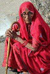 Old Woman in Red (cowyeow) Tags: matriarch lady granny old oldlady teeth badteeth smile friendly smiles smiling rajasthan thepinkcity jaipur india pinkcity street indian travel city portrait people woman indianwoman red candid color composition