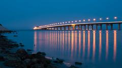 King Fadh Causeway (RomeoJunior) Tags: longexposure nightphotography bridge seascape reflection landscape lights bahrain nikon nightimages postcard engineering bluehour saudiarabia causeway khobar d90 nikond90 kingfadhcauseway