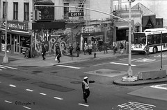 Corner of the Subway Inn (Bruce Livingston) Tags: nyc newyorkcity bw monochrome blackwhite streetphotography rooseveltisland trafficcop rooseveltislandtramway nikon3570mmf28d d800e