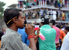 Selling Bubbles (Chiradeep.) Tags: streetphotography festival rath chariot people hawker calcutta kolkata westbengal india