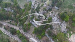 Flying Over Mountain Road (alekseiptitsa) Tags: road park trip travel vacation mountain tree green tourism nature beautiful beauty car rock forest way landscape drive highway scenery europe view outdoor top background scenic silk peak route national valley destination winding roads serpentine