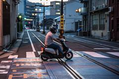 Scooter 2 (kmmanaka) Tags: japan nagasaki evening harbor tram dejima meganebashi scooter