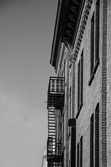 Escape (lacygentlywaftingcurtains) Tags: waterloo ontario building architecture blackandwhite fireescape stairs outdoor outside sky half angle perspective city bricks pattern texture