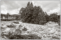 The Falls of Dochart (A.I.D.A.N.) Tags: fallsofdochart falls rapids waterfall waterfalls killin scotland perthkinross highlands water river whitewater cascade clouds bank blackandwhite blackwhite monochrome canon canon5dmarkii canon5dmkii canoneos5dmarkii 5d mkii markii eos daytime scots scottish mono tint border frame framed houses rocks trees afternoon cloudy pace movement deluge