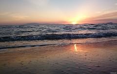 Last light (KOSTAS PILOT) Tags: greece peloponese achaia kalogriabeach mediterranean ionion sea coast beach waves sunset goldenlight goldenhour colors sunlight lowview sky horizon sony sonyz2 xperia kostaspilot scenic reflection lightbeams light                 sand