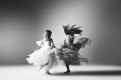 Girls... (Jennifer Blakeley) Tags: girls children dance twirl portrait monochrome dramatic dreamy artistic fun