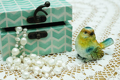 Small treasures (judith511) Tags: stilllife bird necklace box lace jewellery ornament doily odc perals tabletopphotography openandcloses