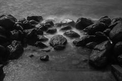 Long exposed rocks #1 of 2 (' A r t ') Tags: longexposure sea blackandwhite bw water monochrome copenhagen denmark mono movement rocks raw outdoor foggy highlight cammelbeeck arthurcammelbeeck artcammelbeeck wwwflickrcomphotosartcammelbeeck camelendk