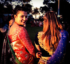 The last of the light (Chi Tranter) Tags: light park outdoors sari red green gold women woman smile look celebration sydney australia friends moments palm trees outside culture