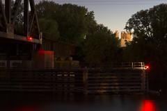 Night Rail (Dr Magnus) Tags: railroad bridge mississippi river night time darkness water under the red light tress outdoors outside industry industrial backdrop background shore boats twin cities minnesota usa wind motion blur
