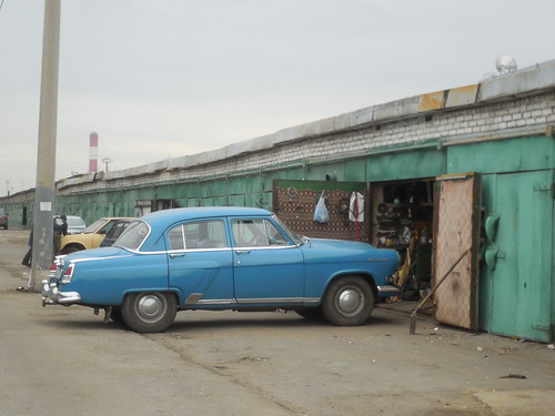 Volga GAZ-21 and old garage, Moscow, Russia