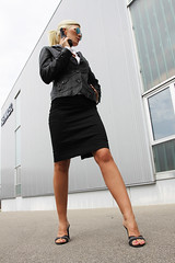 Nicole 18 (The Booted Cat) Tags: woman sexy feet girl sunglasses leather office high toes gun legs blouse business weapon blonde heels miniskirt lighheels
