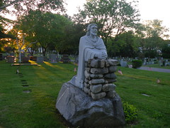 IMGP9372 Calvary Cemetery (shutterbroke) Tags: sunset cemetery statue for pentax praying jesus ct optio behind waterbury deliverance calvary ws80 shutterbroke
