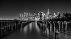 From the other side (rh89) Tags: new york city nyc light shadow sky urban white ny black water monochrome brooklyn night plane airplane lights mono pier long exposure cityscape shadows view angle manhattan sony air wide trails trail fe 1635 1635mm a7r