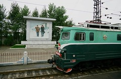 DPRK station scene (Frhtau) Tags: dprk north korea korean people leute asia asian east nordkorea passers architecture gauge line station bahnhof gare propaganda hamhung building gebude architektur design scenery   choxin  outdoor      corea del norte core du nord coreia do coria    culture stadt public