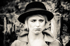 Pouty face (sophie_merlo) Tags: fashion model beauty beautiful woman models hat autumn fall pouting sad sulk sulking fedup miserable emotions mood bowlerhat bw mono noir blackandwhite portrait monochrome bn face people moody