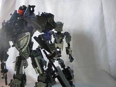 The Adversary 11 (quartzroolz) Tags: quartz roolz moc big burly man bionicle robot toa titan android bustersword guns skull spider mask god thats alot over design