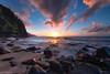 Sunset at Ke'e Beach - Kauai (Captures.ch) Tags: ngc sunset rays sun sea pacific stones cliffs water trees clouds sky perfect nature landscape hawaii kauai keebeach kee blue red orange black white gray brown waves green