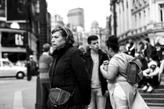 People-watching (TOMSHARMANWEB) Tags: world street old people urban bw woman white black male london public look field female canon buildings ads photography 50mm eyes focus raw traffic eagle bokeh circus f14 cab taxi magic 14 crowd ad young gap piccadilly eyed lantern jpeg depth ldn 600d 60d