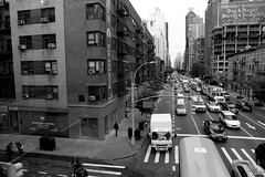 (eflon) Tags: street city nyc bw ny newyork monochrome traffic manhattan perspective tram east midtown elevated bldgs