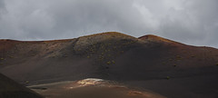 The Badlands (Preston Ashton) Tags: rock clouds volcano rust iron cloudy hill bad vulcan badlands lands volcanic prestonashton
