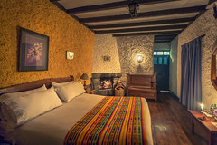 cosy room with fireplace at Hacienda Pinsaqui (iSteven-ch) Tags: southamerica canon hotel ecuador fireplace candle room hacienda otavalo ec hosteria imbabura eos6d haciendapinsaqui panamericananorte