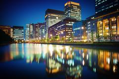 Tokyo Cityscape (marco ferrarin) Tags: travel urban reflection tokyo cityscape ripple memory imperialpalace moat hibiya marunouchi