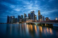 SIngapore Skyline (teemu.jpeg) Tags: singapore jubileebridge marinabay rafflesplace clodysingapore blueandyellow reflections longexposure cityscape city downtown