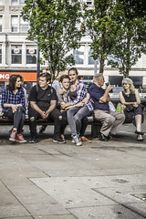 Six in a row (tootdood) Tags: canon70d streetcandid candid fromthehip manchester flickrd people sitting sit sat seated six row seat bench trees green leaves outdoor piccadilly