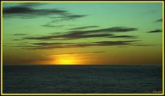 Behind the Ocean Horizon (Irina Kiseleva) Tags: sun sky water ocean cloud reflection nature composition color green black yellow orange photoborder 1001nights