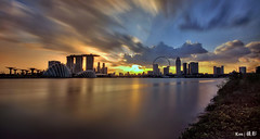 Singapore Skyline (re-processed) (Ken Goh thanks for 2 Million views) Tags: singapore skyline sunset golden sun blue sky reflection water smooth silhouette rays pentax k5iis gardenbythebay marinabarrage citiscape k5 sigma 1020