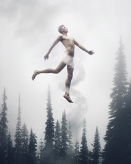 Smoke Signals (Rob Woodcox) Tags: surreal conceptual fineart dreamy whimsical magical fog smoke pine pinetrees forest nature robwoodcox robwoodcoxphotography nude naked male man skin bare trees sky cloud beauty deep gay thought meaning hair quiet different
