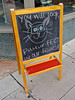 Cat with Glasses, Greensboro, NC (Robby Virus) Tags: our sign cat chalk store frames kitty northcarolina greensboro meow eyeglasses spectacles optometrist purrfect