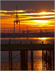 Southampton docks (Maw*Maw) Tags: sunset reflection canon lens eos pier town shadows crane ships terminal quay container 7d southampton 70200l