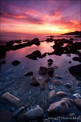 Explosion Of Red (Valerio Musi Photographer) Tags: sunset shadow sea cloud sun reflection water reflex rocks tramonto nuvole mare seascapes ombra sole sassi rocce acqua musa manfrotto onde scogliera riflesso sigma1224 piombino d700 viaamendola visipix wwwvaleriomusiit