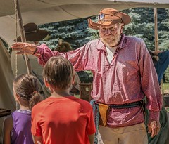 You see, back in those days... (Wes Iversen) Tags: cassrivercolonialencampment frankenmuth michigan nikkor18300mm beards costumes gestures hats kids men reenactments reenactors tents