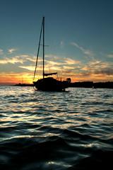 Blue waters.... (Wrinkledpeach) Tags: sunset boat water sea ripples waves seaside
