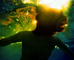 Gentle Starving (stefanodealessandri) Tags: water girl sunset breath wave starving hug hair summer colour skin yellow blue green life death