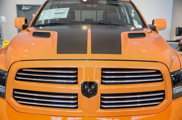 hemi v8 augustaga orangetruck 57l automatictransmission 8speed rubberfloormats orangepickup ramtrucks amplifiedspeaker ignitionorange sportpickup 2015ram1500 sportcrewcab flatblackhemibadging sportperformancehood miltonrubenram shopramsaugusta