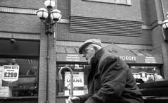 Flat Cap (4foot2) Tags: street leica people blackandwhite bw man film monochrome hat cane closeup 35mm manchester close kodak tmax candid coat streetphotography hc110 rangefinder oldman summicron walkingstick cap 35mmfilm stick streetphoto analogue m3 peoplewatching reportage wigan 400iso streetshot flatcap reportagephotography kodaktmax filmphotography 2015 greatermanchester printfilm interestingpeople leicam3 manchesterpeople 4foot2 candidportrate 4foot2flickr 4foot2photostream fourfoottwo